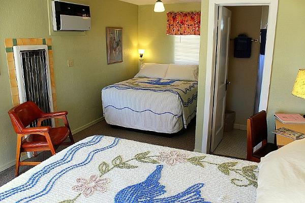 Room 10 features a non-traditional layout, with two comfortable beds for 2-4 people.