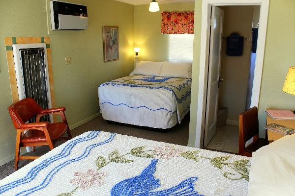 Some rooms at the Blue Swallow have two comfortable beds.