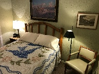 Each room features unique, authentic period decor, including chenille bedspreads, vintage lighting, and rotary-dial phones from 1939.