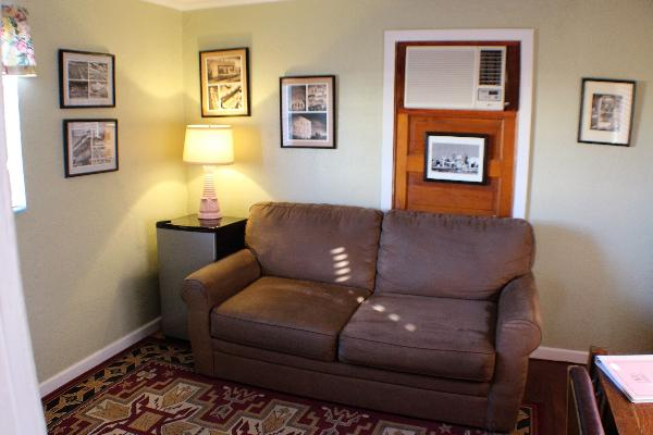 The sofa in the parlor is a comfortable place to relax, read, or watch TV.