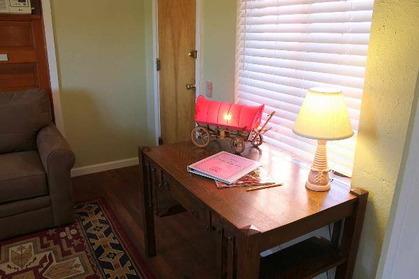 Desk in the parlor is a great place to write postcards to family and friends.