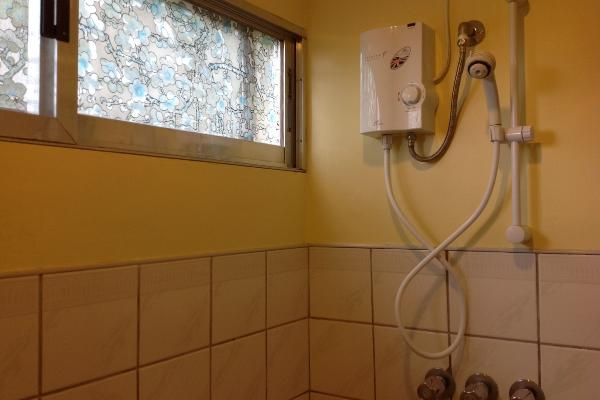 Toilet and a small hot and cold shower