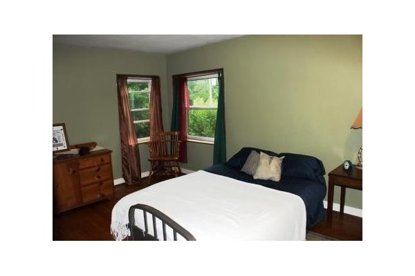 This spacious bedroom is divided by a privacy curtain and is large enough to comfortably accommodate four people.