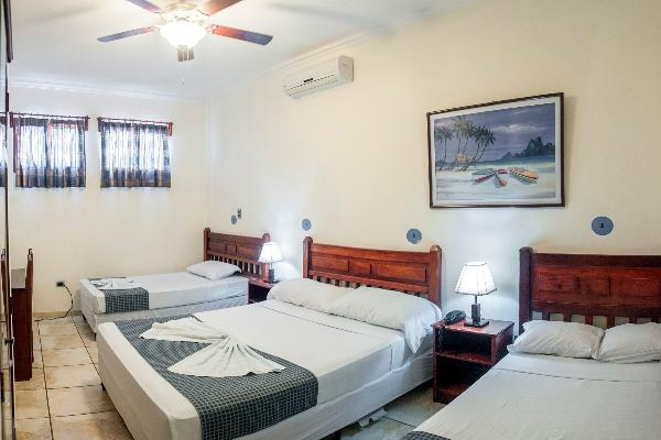 This is a triple room with 2 queen beds and 1 small bed