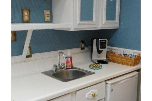 Mini Kitchen with microwave, refridgerator, sink etc
