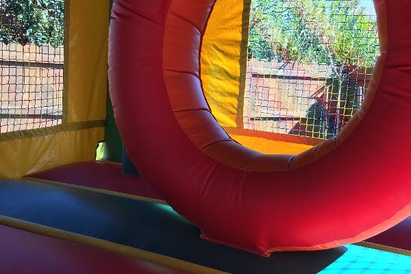 Donut hole and punching posts inside bounce house