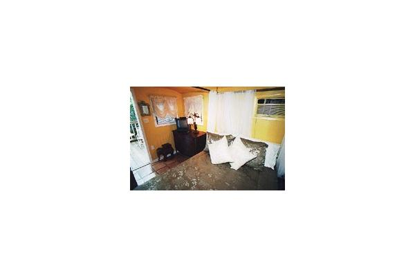 The Tiki Hut is furnished with a full-size bed.