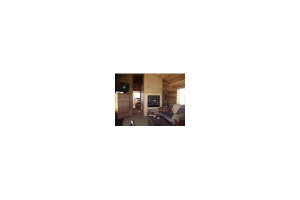 Custom see-thru fireplace, high def-flat screen TV, Cedar interior, leather hidabed, comfy rocker/recliner and more!