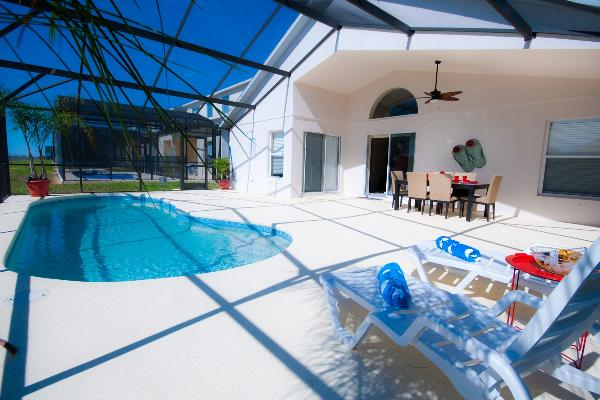 Large Sun Deck, In-ground Heated Pool and Outdoor Dinning Area