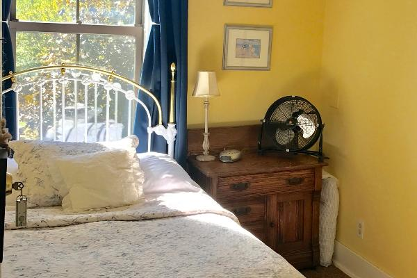 Cassie Room, bright and cheery and conveniently located across from the bathroom. Enjoy our central AC, room-darkening curtains and oh so romantic bedding.
