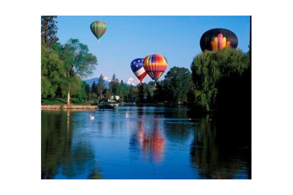 Balloons floating above Mirror Pond along the Deschutes River in downtown Bend Oregon