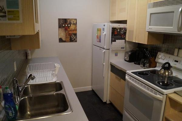 The kitchen is equipped with full size appliances and all accessories.