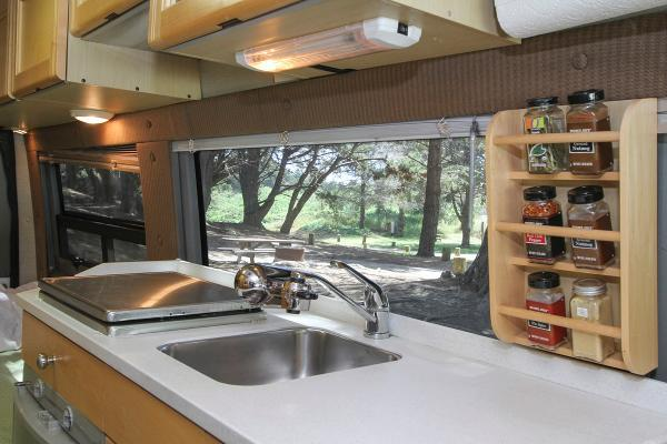 Kitchen with 2 burner stovetop, fridge, toaster oven/micro and sink