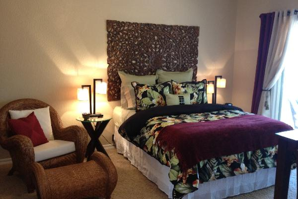 Queen Bed w/down comforter, lounge chair in private room off covered deck.