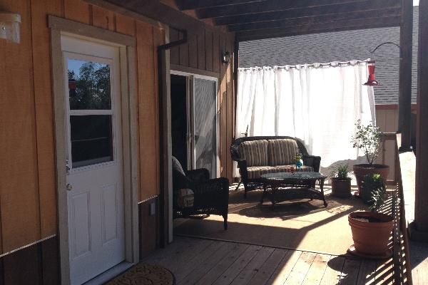 Covered patio with private entrance, patio furniture, BBQ and view of Oak trees