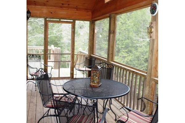 Screened in Porch with view of creek