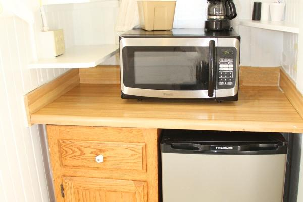 Kitchenette with microwave, refrigerator & coffee maker.
