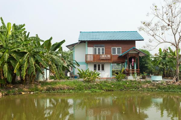 Teakwoodhouse as seen over the talapia fishpond