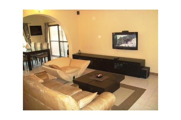 Ultra comfortable Living Room with wall-mounted LCD TV