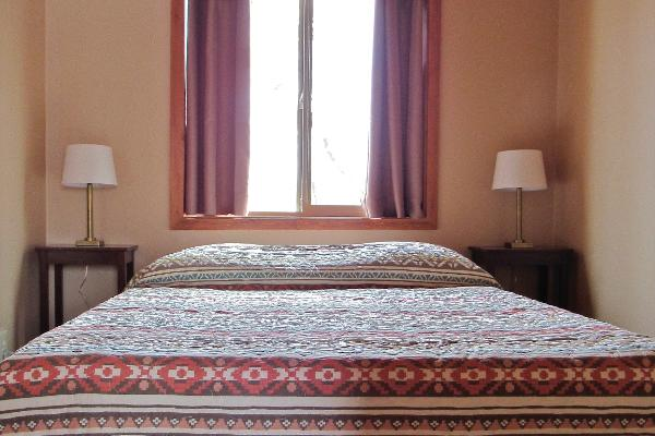Each bedroom features a comfortable queen sized bed.