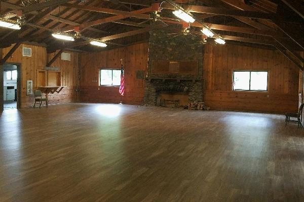 Rustic knotty pine walls, high vaulted ceilings, exposed beams and new flooring.
