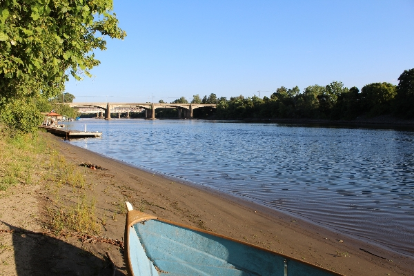 The American River from the shores of Camp Pollock. Looking up river at 160 and the Sacramento Northern Bikeway River bridge to C street.