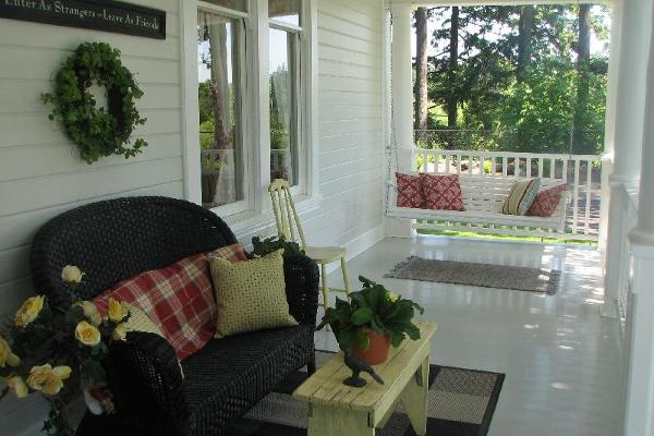 Three covered porches priovide perfect viewing of lawns and gardens