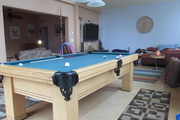 Common area with pool table and access to deck