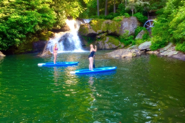Paddleboarders in front of Norton Falls