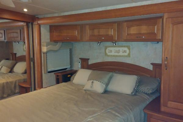 Queen Island Masterbed with lots of wardrobe closets, cabinet and drawer space