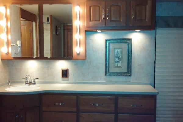Sink, Mirror and Cabinets in Master Bedroom