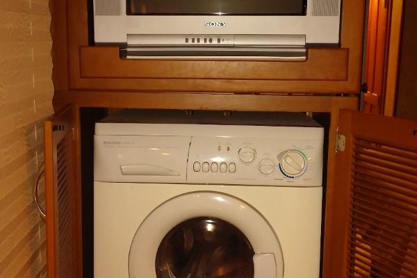 TV and Washer/Dryer Combo in Master Bedroom