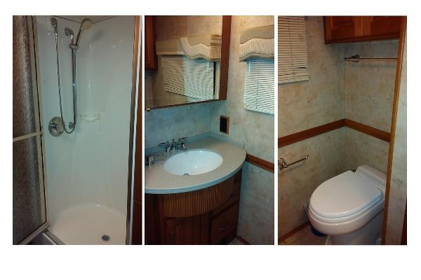 Large Shower with Glass Doors and separate room with toilet, sink and mirror with lots of cabinet space in bathroom