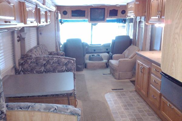 Large living space with built in TV/Entertainment area above driver and passenger area