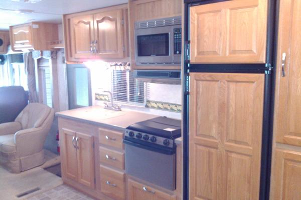 Full Kitchen with stainless steel stove/oven and microwave, large double door fridge/freezer