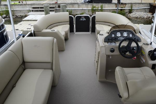 Beautiful interior with nonskid vinyl flooring, captains chair, and more