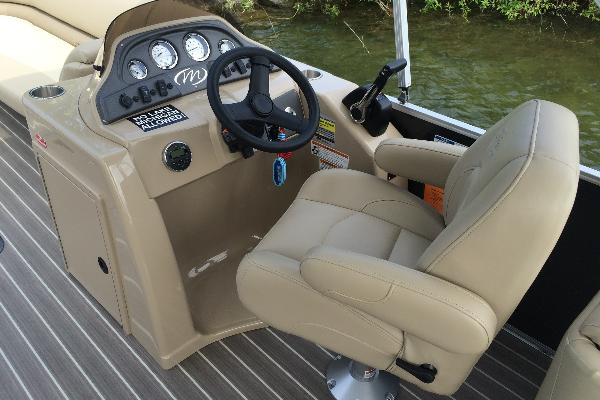 Captains chair and helm.  Bluetooth audio and full instrumentation.