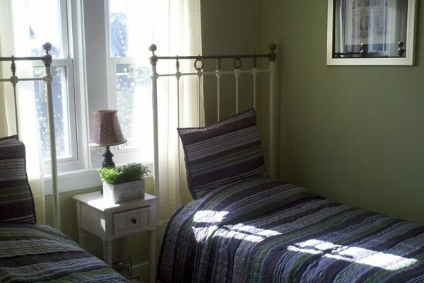 The GREEN ROOM has two twin beds, flat screen tv, cedar lined closet and is one of our coziest rooms.