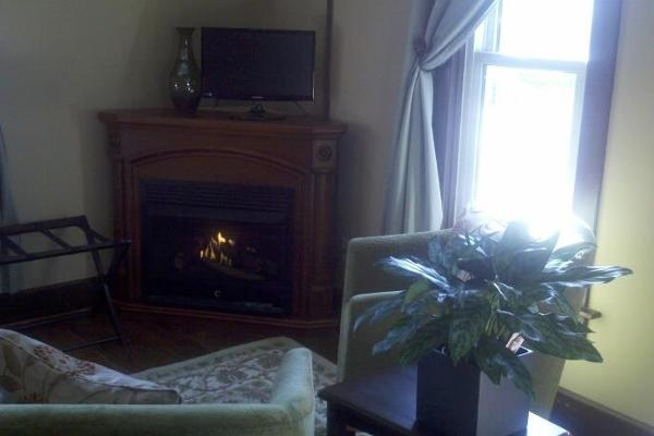 The TAN ROOM with gas fireplace