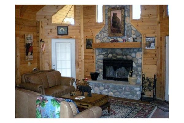 Stone Fireplace in Living Room That is Wood Burning