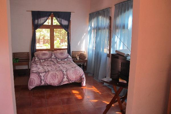 This is the master bedroom with large windows looking at the lake
