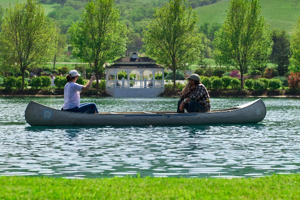 Couple relaxing in a canoe on Dalton Pond